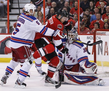 Ottawa Senator Jesse Winchester is stopped by Rangers netminder Henrik Lundqvist as he is checked by Dan Girardi during first period NHL playoff hockey action at Scotibank Place in Ottawa. Monday April 16,2012. (ERROL MCGIHON/THE OTTAWA SUN/QMI AGENCY).