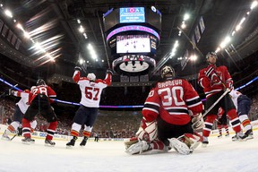 Marcel Goc, of the Florida Panthers, celebrates after teammate Jason Garrison scored a goal in the first period against goalie Martin Brodeur, of the New Jersey Devils, in Game 3 of the Eastern Conference Quarterfinals during the 2012 NHL Stanley Cup Playoffs. (Bruce Bennett/Getty Images/AFP)