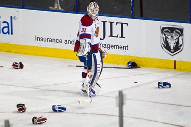 Edmonton's goaltender Laurent Brossoit clears gloves and sticks after a brawl during the third period of the Edmonton Oil Kings' WHL playoff game against the Moose Jaw Warriors at Rexall Place in Edmonton on Sunday, April 22, 2012. The Oil Kings won 6-1. CODIE MCLACHLAN/EDMONTON SUN QMI AGENCY