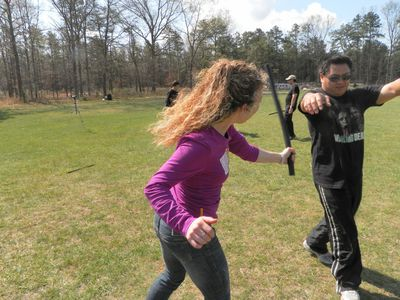 Zombie Survival Course students Pete Legaspi and his wife Laura Legaspi, of Queens, N.Y., practice attacks on the walking dead during recent day of training at the New Jersey facility. (Thane Burnett/QMI Agency)