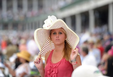 A guest attends the 138th Kentucky Derby at Churchill Downs on May 5, 2012 in Louisville, Kentucky.   Michael Loccisano/Getty Images/AFP