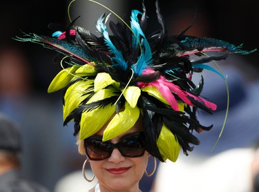 A woman wears a fancy hat at Churchill Downs in Louisville, Kentucky before the 138th running of the Kentucky Derby, May 5, 2012. REUTERS/Jeff Haynes