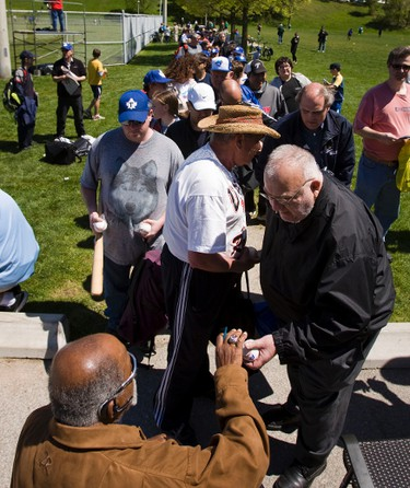 (19) 001TorBaseball07.JPG. Baseball specators line up to get an autograph signed by Major League great - Luis Tiant  before the start of the season opener where the Toronto Maple Leaf Baseball club hosted the Ottawa Fat Cats at  Dominico Field at Christie Pits in Toronto on Sunday May 6, 2012. Ernest Doroszuk /TORONTO SUN/QMI AGENCY.