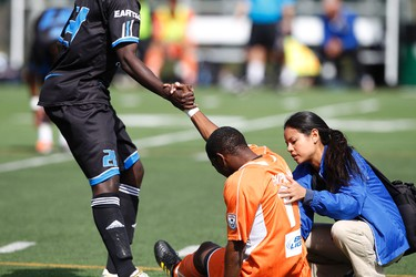 Carolina Railhawks midfielder Ty Shipalane is helped up by FC Edmonton midfielder Dominic Oppong after a hard fall during the second half of FC Edmonton's game against the Railhawks at Clarke Field in Edmonton, Alberta, on May 6, 2012. The local soccer team beat the Railhawks 3-0 with a trifecta of goals from Shaun Saiko. Edmonton heads to Vancouver to take on the Whitecaps. Their next home game is May 27 versus the San Antonio Scorpions. IAN KUCERAK/EDMONTON SUN/QMI AGENCY