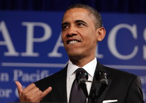 U.S. President Barack Obama gives the Hawaiian gesture shaka at the Asian Pacific American Institute for Congressional Studies (APAICS) 18th annual gala dinner in Washington on May 8, 2012. (REUTERS/Yuri Gripas)