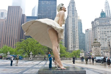 Tourists get a last look before the sculpture of Marilyn Monroe is dismantled as it prepares to travel to Palm Springs, California on May 7, 2012 in Chicago, Illinois.  Timothy Hiatt/Getty Images/AFP