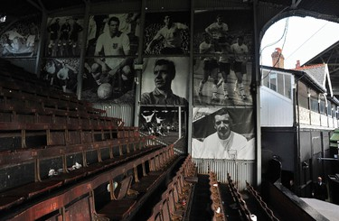 Original wooden seating and archive photographs are seen displayed on the Johnny Haynes stand following Fulham's Premier League soccer match against Wigan Athletic at Craven Cottage in London April 21, 2012.  Fulham was one of several London clubs to host Olympic soccer matches in the 1948 Olympics, and parts of the stadium dating from the early 20th century including the 1905 Johny Haynes stand and Cottage remain in use today giving the venue a unique atmosphere. REUTERS/Toby Melville