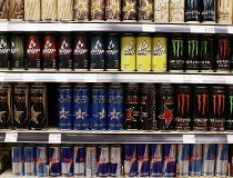Energy drinks on a shelf - including Red Bull
