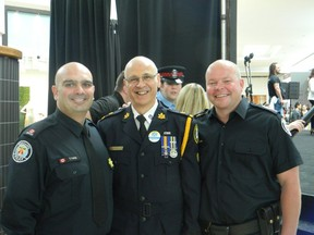 Const. Tony Vella, Deputy Chief Mike Federico and Staff Sergeant Chris Boddy have a big heart and no hair.