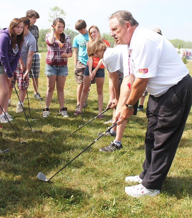 Gary Price, of the CN Future Links youth golf program, teaches a group of SPS students the proper grip when holding a golf club.