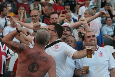 A fan of England's national football team with a tattoo on his back waits prior to the Euro 2012 championships football match France vs England on June 11, 2012 at the Donbass Arena in Donetsk. AFP/ALEXANDER KHUDOTEPLY