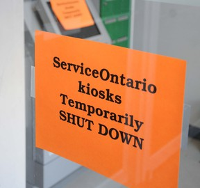 W. BRICE MCVICAR The Intelligencer Signs are posted to the door and the Service Ontario kiosk at Century Place in Belleville informing residents the machine is down for a temporary basis. All machines across Ontario have been shut down by the province after security concerns.