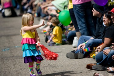 Litl Skin, 3, participated in her first pride parade with her family during the 2012 Stand Out Parade in Edmonton, Alberta on Saturday, June 9, 2012. Pride parade marchers walked along 102 Avenue from 109 Street to Churchill Square where a festival was held. IAN KUCERAK/EDMONTON SUN/QMI AGENCY