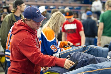 Fans, including Kevin Elliott, checked out merchandise during the annual Oilers Locker Room Sale held at Rexall Place in Edmonton, Alberta on Sunday, June 10, 2012. Fans picked up game used items, souvenirs and toured Oilers facilities. IAN KUCERAK/EDMONTON SUN/QMI AGENCY