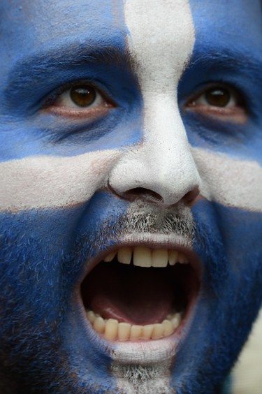 A Greek fan cheers during the Euro 2012 championships football match Greece vs Czech Republic on June 12, 2012 at the Municipal Stadium in Wroclaw.        AFP PHOTO / ARIS MESSINIS
