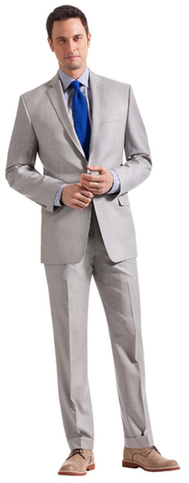 A 100% wool, pearl grey suit ($450), dress shirt ($70) and tie ($60) will keep dad sharply suited and comfortably cool. All Tip Top Tailors. (Supplied)