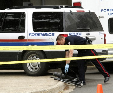 An Edmonton police member removes a metal battering ram and metal pry bars from the U of A HUB Mall & Residence which was the scene of a multi-fatality shooting in Edmonton on Friday June 15, 2012. TOM BRAID/EDMONTON SUN  QMI AGENCY