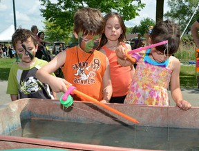 Children try their luck and patience as the participate in a fishing game on Saturday June 9, 2012 during the 9th annual Family Fun Festival at Kelso Park in Owen Sound.