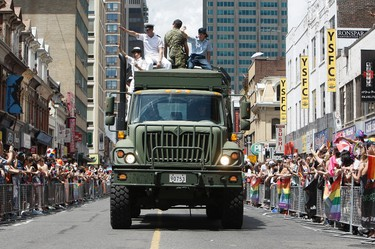 Roughly a million people flooded Yonge St. for the 32nd annual Pride Parade in Toronto July 1, 2012. (Dave Abel/QMI Agency)