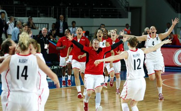 Canada's players celebrate their victory against Japan during their 2012 women's FIBA Olympic Qualifying Tournament in Ankara July 1, 2012. Canada won the match and qualified for the London 2012 Olympic Games. REUTERS/Umit Bektas (TURKEY - Tags: SPORT BASKETBALL OLYMPICS)