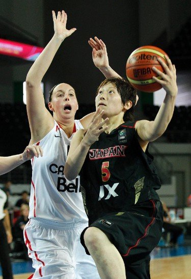 Japan's Maki Takada (R) goes for a basket against Canada's Krista Phillips during their 2012 women's FIBA Olympic Qualifying Tournament in Ankara July 1, 2012.  REUTERS/Umit Bektas (TURKEY - Tags: SPORT BASKETBALL OLYMPICS)
