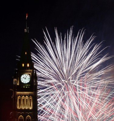 Fireworks explode behind the Peace Tower on Parliament Hill in downtown Ottawa Sunday, July 1, 2012. (QMI AGENCY/DARREN BROWN)