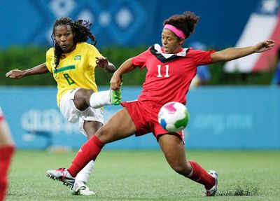 Midfielder - Desiree Scott, PHOTO: Scott (R) tries to block Miraildes Mota of Brazil in their women's soccer gold medal match at the Pan Amerian Games in Guadalajara last October. (REUTERS)