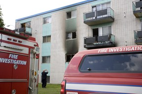 Edmonton Fire Rescue Services investigators spent the morning investigating after an early morning fire in a low-rise apartment complex at 8516 99 Street in Edmonton, Alberta, on July 8, 2012. Three men and a woman were taken to hospital. The woman is being treated for burns while the three men are being treated or smoke installation. IAN KUCERAK/EDMONTON SUN/QMI AGENCY