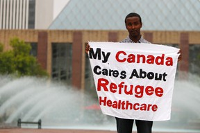 Bashir Mohamed, 17, poses for a photo outside of Edmonton City Hall in Churchill Square in Edmonton, Alberta, on July 15, 2012. Mohamed was removed from a Conservative Party of Canada barbecue for asking  Immigration Minister Jason Kenney about cuts to refugee claimants healthcare benefits. Mohamed came to Canada when he was three years old. He said he was arrested by security personnel after he tried to unfurl a banner at the event. IAN KUCERAK/EDMONTON SUN/QMI AGENCY