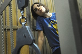 Nadezhda Tolokonnikova, a member of female Russian punk band Pussy Riot, sits inside a defendants cage in a Moscow  court on July 4, 2012, during the hearings on the Pussy Riot case. (AFP PHOTO/ALEXANDER NEMENOV)