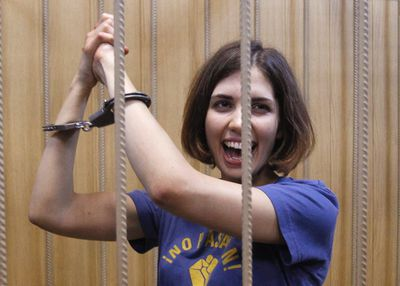 Nadezhda Tolokonnikova, a member of female punk band, Pussy Riot, reacts behind bars during a court hearing in Moscow July 4, 2012.  REUTERS/Sergei Karpukhin