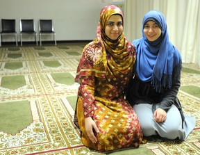 Saba Ali, 22 (left), and Marwa Elkelani, 20, prepare for night prayers at the Sarnia Mosque following 'iftar' (breaking fast meal) on their first full day of fasting in the Islamic month of Ramadan. (file photo)