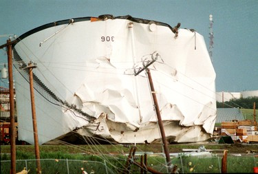 A oil tank is seen flipped over on refinery row off of Baseline Rd., after a massive tornado hit Edmonton on Friday July 31, 1987. The tornado killed 27 people and injured hundreds, it also caused over $330 million in property damage. TOM BRAID/EDMONTON SUN  QMI AGENCY