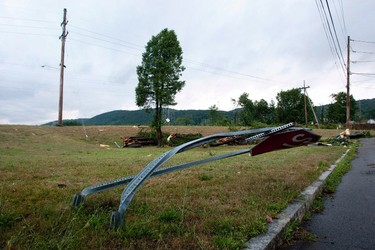 A bent stop sign is pictured the morning after the town was hit by a tornado in Elmira, New York July 27, 2012.     REUTERS/Adam Fenster