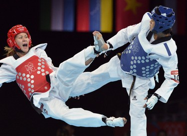Thailand's Chanatip Sonkham (R) fights against Russia's Kristina Kim during their women's taekwondo bout in the category under 49 kg as part of the London 2012 Olympic games, on August 8, 2012 at the ExCel centre in London. AFP PHOTO / ALBERTO PIZZOLI