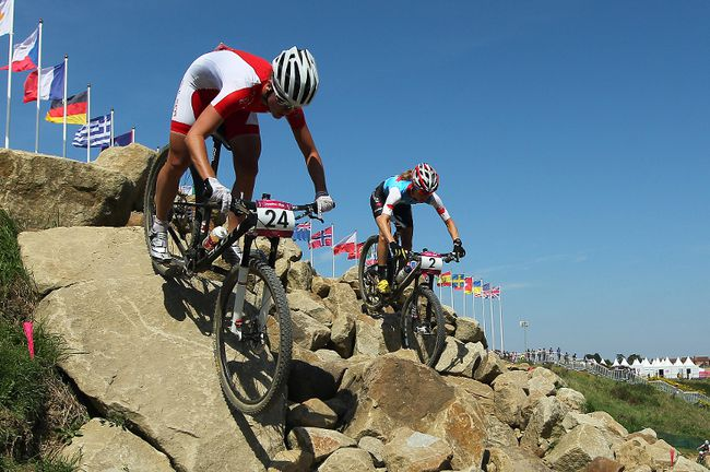 Aleksandra Dawidowica of Poland battles for position with Catharine Pendrel of Canada during the Women's Mountain bike race during the 2012 Olympic Summer Games in London.