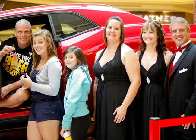 PHOTO SUPPLIED. (left to right) Brad Zadunayski, with daughters Katelyn and Jamie, pose in their new car with Tineke de Jong, Charlene and Jordon of Londonderry Mall. The draw for the car happened on Aug. 10 and Zadunayski drove it home on Aug. 11.