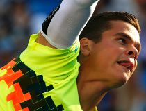 Raonic struggles, but finds his 'courage' to win at U.S. Open
