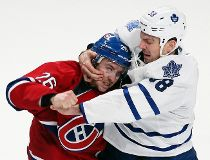 Montreal Canadiens Josh Gorges, left, and Toronto Maple Leafs Frazer McLaren fight during third period NHL hockey action in Montreal, Feb. 9, 2013. (REUTERS/Christinne Muschi)