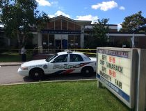 Police on scene at North Albion Collegiate, on Kipling Rd. just north of Finch Ave. W., after a student stabbing. (CHRIS DOUCETTE/Toronto Sun)