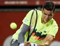 Milos Raonic moves on, Eugenie Bouchard out