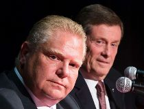 Toronto mayoral candidates Doug Ford, foreground, and John Tory. (Reuters file)
