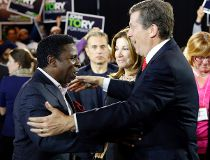 """Football great Mike """"Pinball"""" Clemons steps up to embrace Toronto mayoral candidate John Tory last night at a fundraising dinner.(MICHAEL PEAKE/Toronto Sun)"""