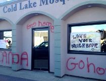 Graffiti covers the front of the Cold Lake mosque after it was vandalized overnight,