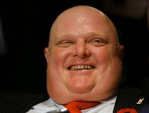 Mayor Rob Ford laughs while watching the municipal election results in Toronto