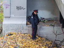 Police work at the scene Thursday where a burned body was reportedly found the night before. (ERNEST DOROSZUK/Toronto Sun)