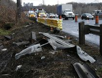 Police say a hit and damaged this guardrail before going into a ditch. (CRAIG ROBERTSON/Toronto Sun)