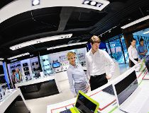 People in consumer electronics store