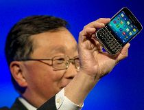 BlackBerry CEO John Chen holds a BlackBerry Classic