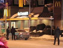 Police at the scene of a double homicide inside at McDonalds on Danforth Ave. near Coxwell Ave. (JOHN HANLEY/Special to the Toronto Sun)